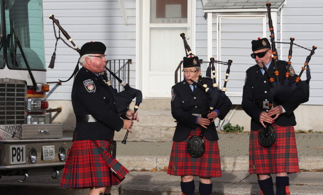 Bagpipers play at event